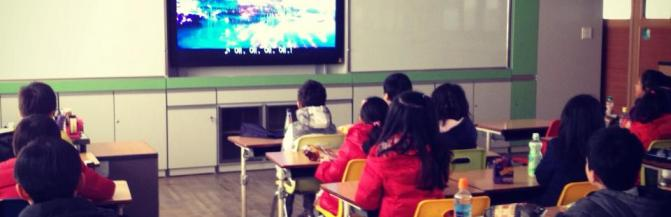 Students watching a TV